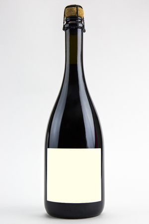 Red wine bottle isolated on white background.
