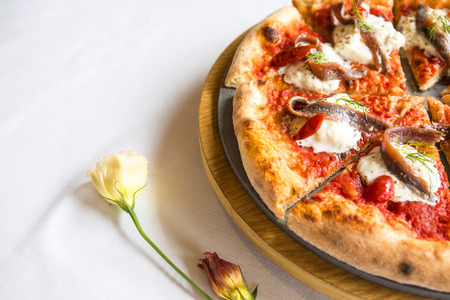 Rustic italian pizza on white background.