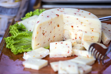 Italian cheese with hot chili pepper .