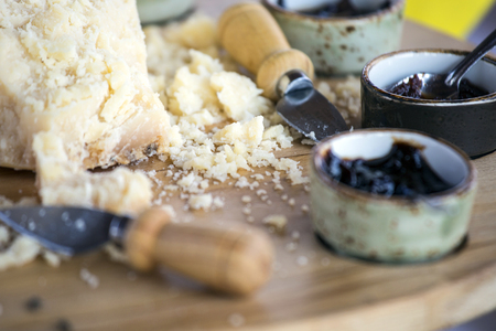 Pieces of italian parmesan cheese with cherry jam.