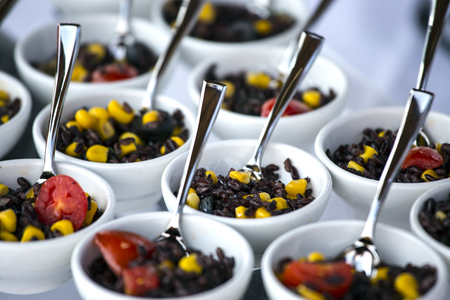 Black rice salad with maize and tomato.