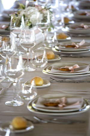 Table setting for a wedding reception .