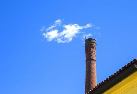 Fake smoke over the tower of the italian castle.
