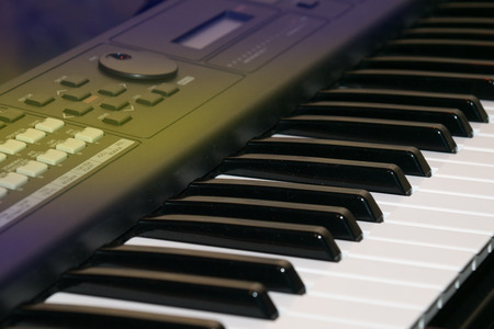 Close up of keys of an electric piano in perspective photo