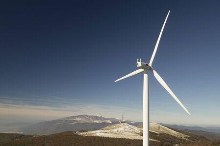 regenerating: Wind turbine with landscape and blue sky