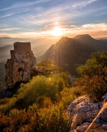Old Castle staring at Fall's colors: Sunset taken in the French Cathare region the day before the last moon eclipse.