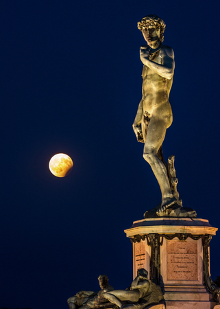 The Moon at His feet, Piazzale Michelangelo, Florence, Tuscany, Italy, Europe Statue of David by Michelangelo the evening of the 7th August 2017 with the Full Moon at Partial Eclipse. Editorial