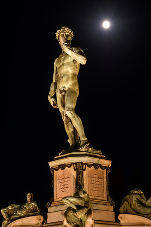Under a Giant spotlight, Piazzale Michelangelo, Florence, Tuscany, Italy, Europe Statue of David by Michelangelo the evening of the 7th August 2017 with the Full Moon. Editorial