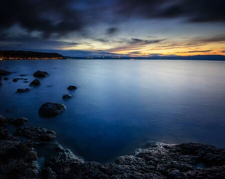 Growing Darkness: as the Sun dove deep in the horizon, black clouds invaded the place eating the remained light. Lake di Bracciano, Province of Rome, Lazio, Italy, Europe.