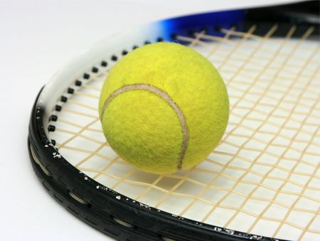 Tennis ball on the racket - isolated on white photo