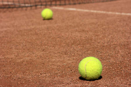 Two tennis balls on a tennis field photo