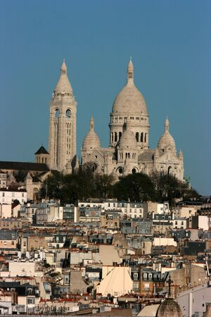 Cityscape of Paris with the Sacre Coeur basilica rising above the rooftops photo
