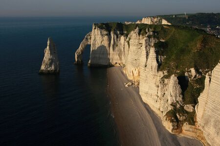 Cliffs and a natural arch, Etretat, Normandy, France   photo