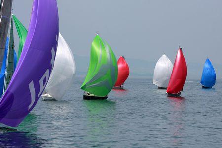 Colorful cruising sailboats