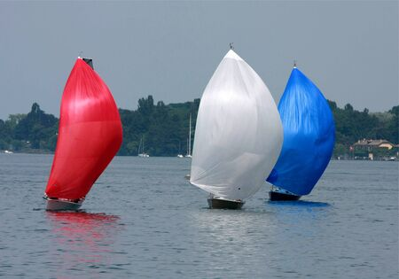 cruising: Three colorful cruising sailboats