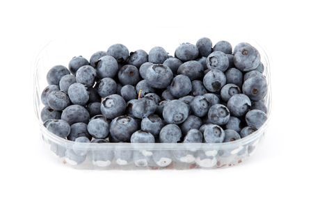 tupperware: Plastic tupperware full of blueberries