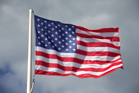 American flag waving against a cloudy sky  Banque d'images