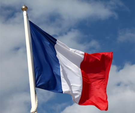 French flag waving in the wind photo