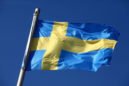 Swedish flag waving in the wind photo
