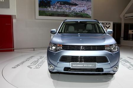 plugin: The Mitsubishi Outlander PHEV plug-in Hybrid CUV displayed at the 2012 Paris Motor Show on September 30, 2012 in Paris