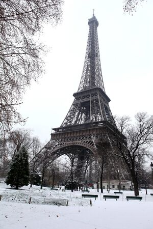 Wide-angle view of the Eiffel Tower in winter time photo