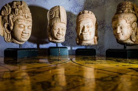 Buddha heads displayed on a old world map photo