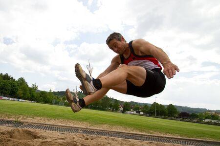 salto largo: salto de longitud Foto de archivo