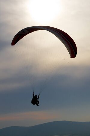 activ: paraglider in back light