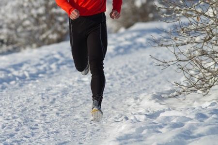 athlete running in the snow photo