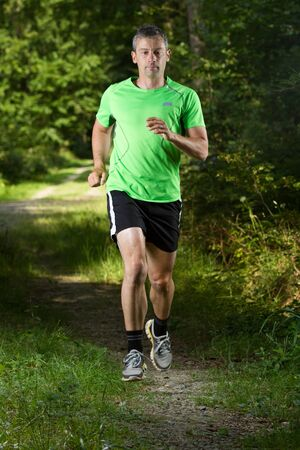 A jogger running in the forest