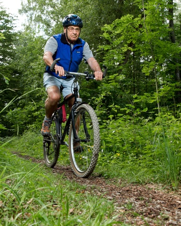 senior on a mountain bike photo