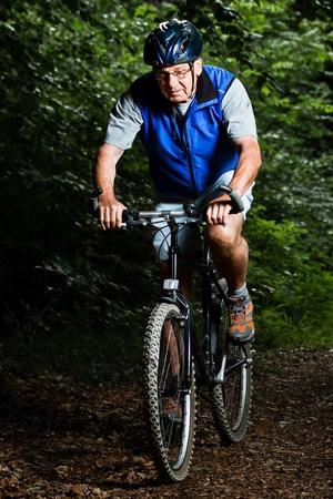 senior on a mountain bike photo