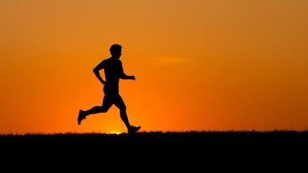 runner in sunset Standard-Bild
