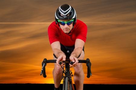 races: triathlete on a bicycle Stock Photo