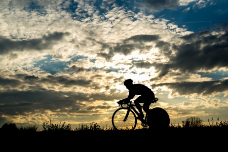 cyclist in a sundown Stock Photo