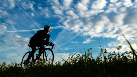 triathlon: cyclist in a sundown Stock Photo