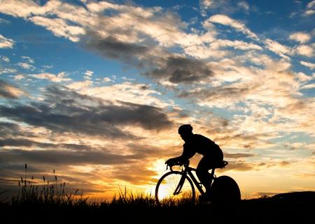 cyclist in a sundown Standard-Bild