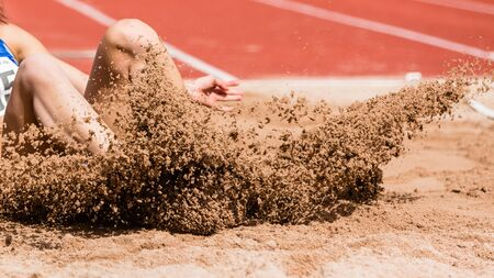 long jump: long jump in track and field Stock Photo