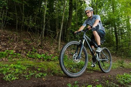 mountain biker: mountain biker on a trail Stock Photo