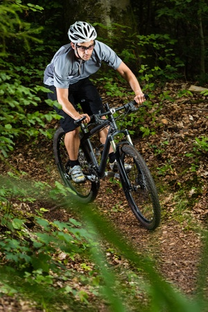 bike trail: mountainbiker in the forest Stock Photo