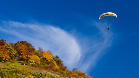 paraglider flying in autumn Stock Photo
