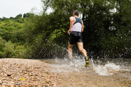 trailrunner in a streambed