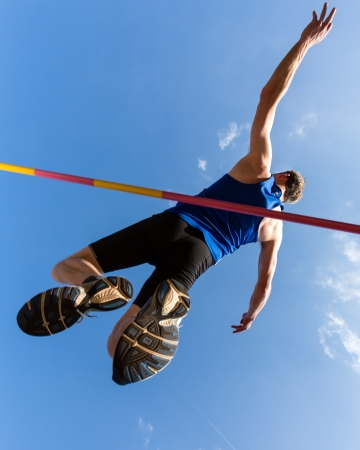 individual sport: High jump in track and field Stock Photo