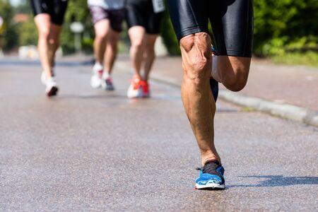 runner in a triathlon competition Standard-Bild