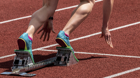 yellow block: sprint start in track and field Stock Photo