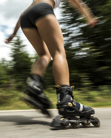 young woman inline skating Stock Photo