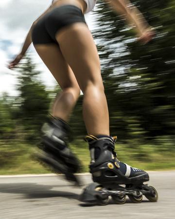 inline skating: young woman inline skating Stock Photo