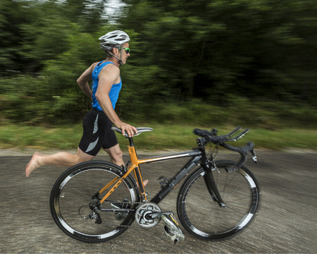 triathlete with bicycle