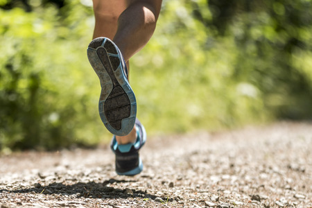 feet of a running athlete