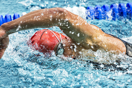 swimming race: Swimmer in a competition Stock Photo